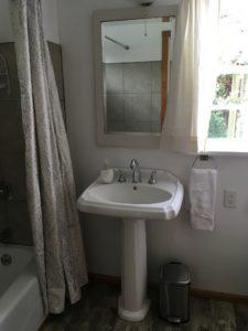 Vanity and full tub